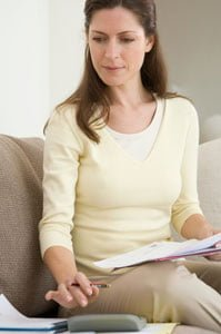 Women creating an inventory list for homeowners insurance