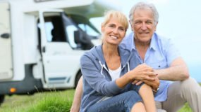 older couple in front of rv
